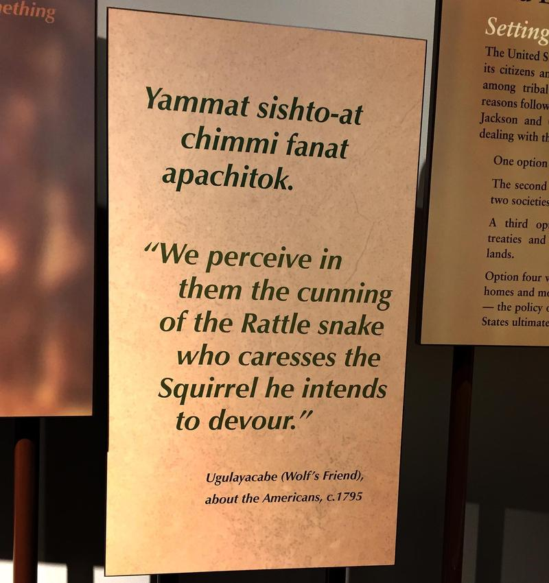A bilingual sign in the Chikasha Poya Exhibit Center at the Chickasaw Cultural Center in Sulphur, Okla.