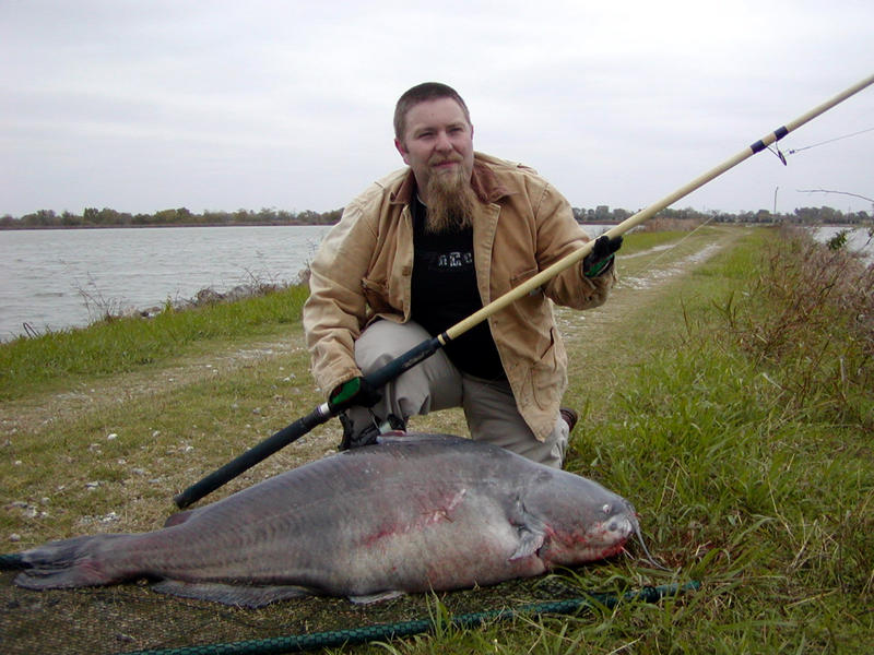 Angler Billy Nabors catches a state record 98 pound blue catfish with a rod and line in Lake Texoma, November 2004.