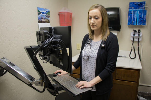 Lindsi Walker, a nurse practitioner, insider her office at Cordell Memorial Hospital.