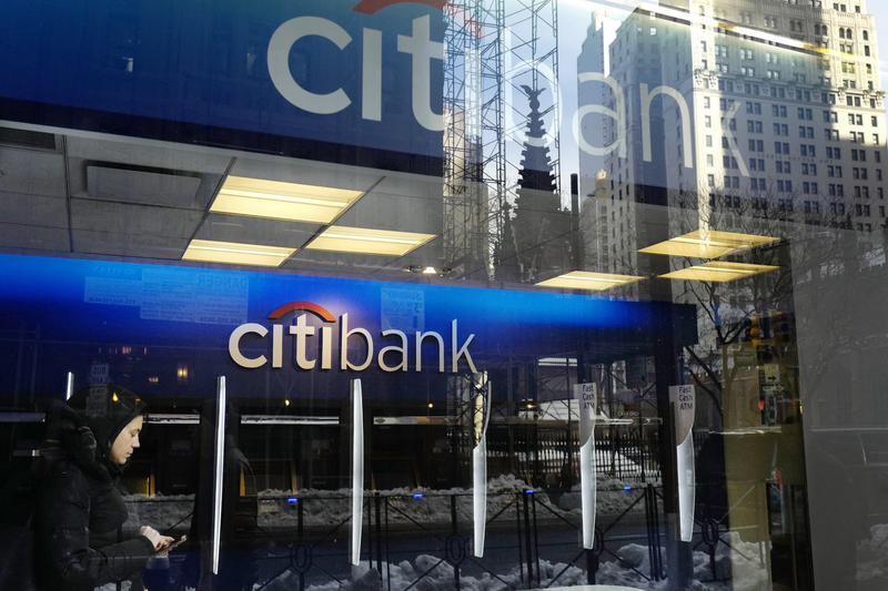A customer enters a Citibank, Thursday, March 16, 2017 in New York.