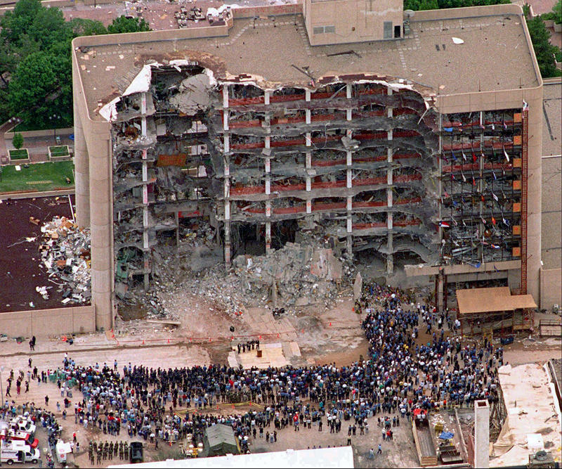 In this May 5, 1995 file photo, a large group of search and rescue crew attends a memorial service in front of the Alfred P. Murrah Federal Building in Oklahoma City.