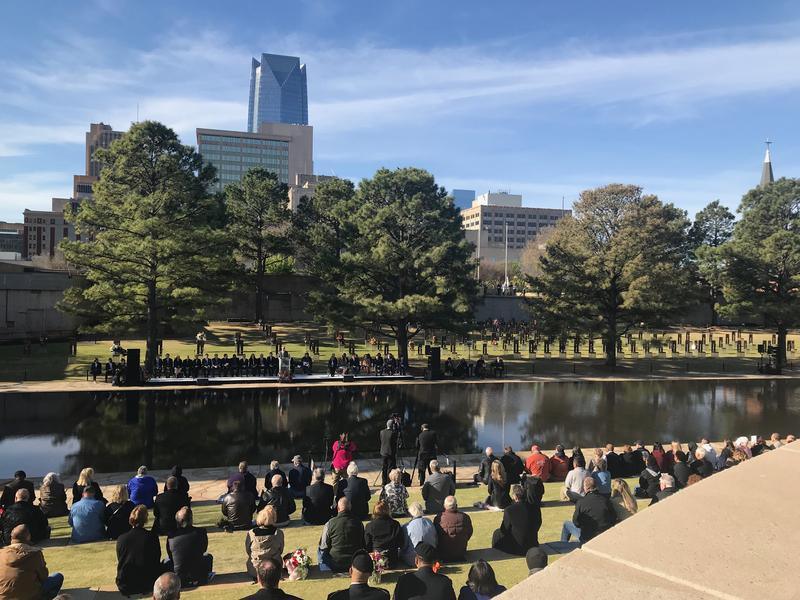 Attendees listen to opening remarks during the 23rd anniversary ceremony of the Oklahoma City bombing on April 19, 2018.
