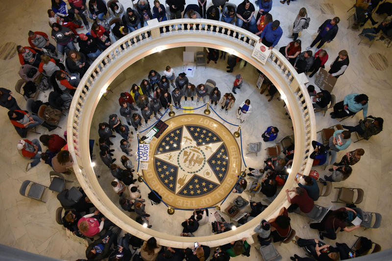 Teachers gather to chant in the rotunda of the Oklahoma state capitol building on April 4, 2018 while lawmakers are in session.