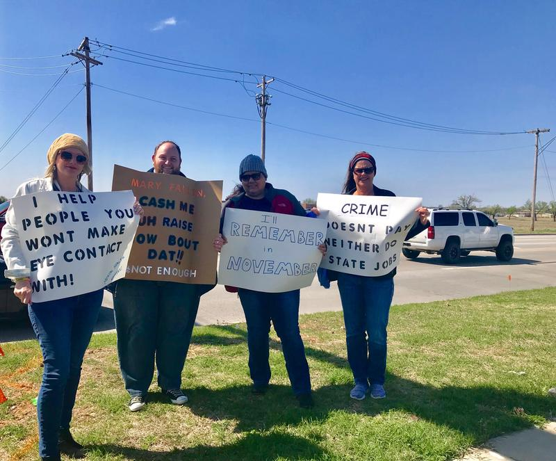 (From left to right) State employees Jennifer Malwick, J.R. Holaday-Herrington, Kim Harjo and Missi Webb demonstrate in Norman on April 3, 2018.