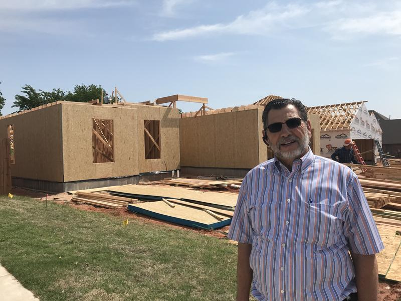Marvin Haworth stands outside a home his business is constructing in Moore, Oklahoma on May 14, 2018.