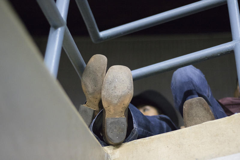 Many attendees of the Cowboys of Color Rodeo wore cowboy boots.