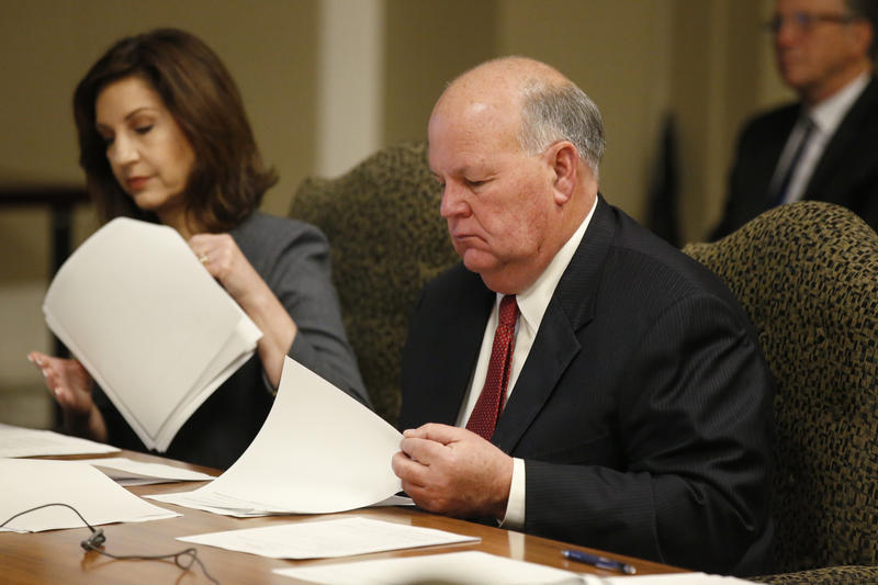 Gary Jones, right, Oklahoma State Auditor and Inspector, looks over papers during a Board of Equalization meeting in Oklahoma City, Tuesday, Feb. 20, 2018.
