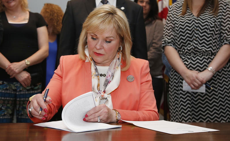Oklahoma Gov. Mary Fallin signs public safety legislation designed to reduce the state's prison population, at the state Capitol in Oklahoma City, Thursday, April 26, 2018.