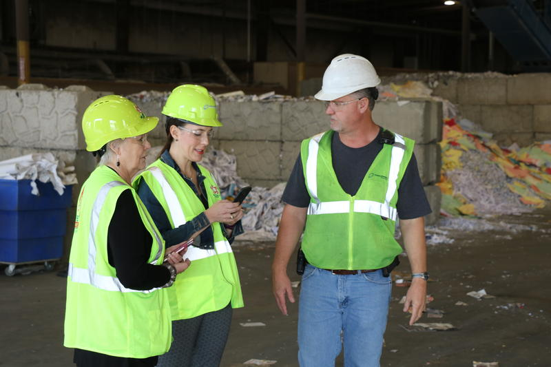 Batliner Recycling general manager Scot Stonebraker (right) shows Norman Mayor Lynne Miller (left) and Ward 6 Councilwoman Breea Clark (center) the west Oklahoma City sorting facility.