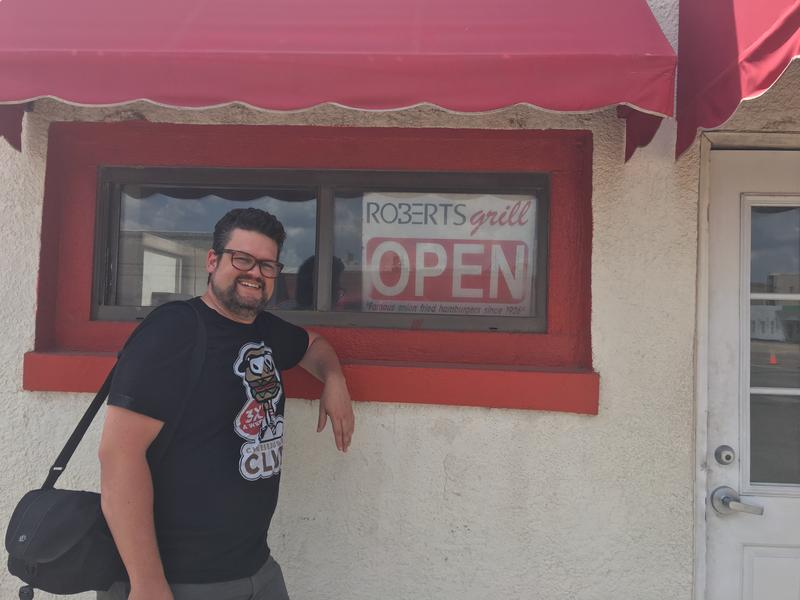 How Curious question-asker Greg Elwell stands outside Robert's Grill in El Reno. Elwell asked How Curious if it's illegal in Oklahoma to take a bite of someone else's hamburger.