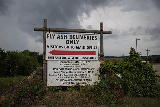 A sign marks the entrance to a coal ash reclamation pit near Bokoshe in southeastern Oklahoma.