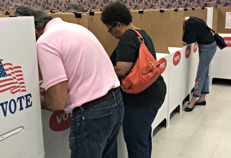Voters cast ballots at the Oklahoma County Election Board Thursday, the first day of voting for the June 26 elections. The slate includes primary races for statewide offices and legislative seats, as well as State Question 788 on medical marijuana.