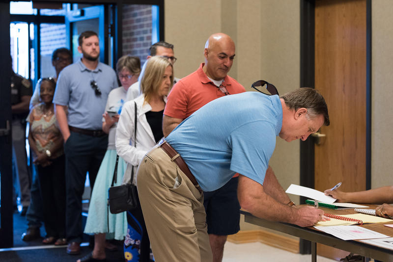 Voters wait in line at a polling station in Oklahoma City on Tuesday.