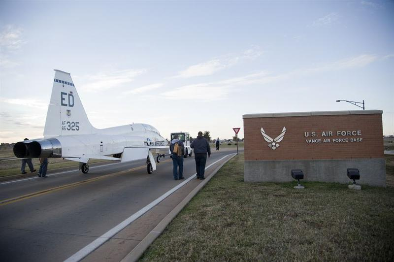 Members of the aircraft maintenance section, help move a T-38 Talon Nov. 1 out of the Vance Air Force Base