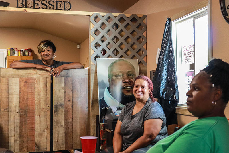 Owner Sylvia Wilson, center, sits with a customer and an employee at Boots Cafe in Taft, Oklahoma.