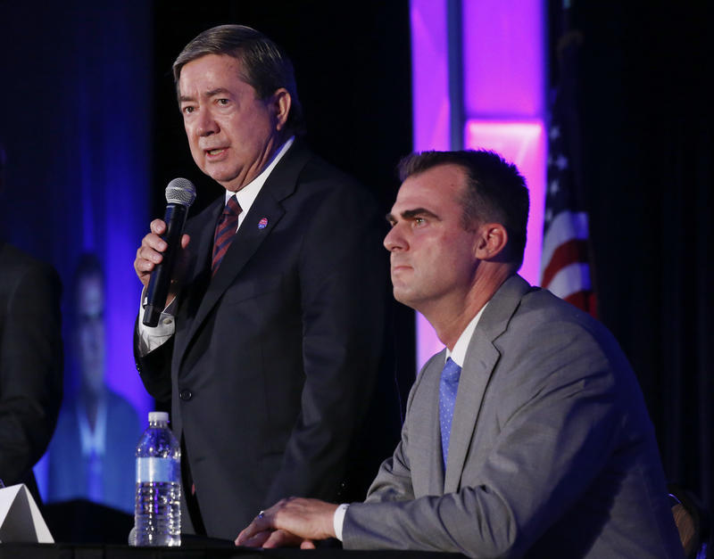 Oklahoma Democratic gubernatorial candidate Drew Edmondson speaks during a candidate forum in Oklahoma City, Friday, Aug. 24, 2018. At left is Republican candidate Kevin Stitt.