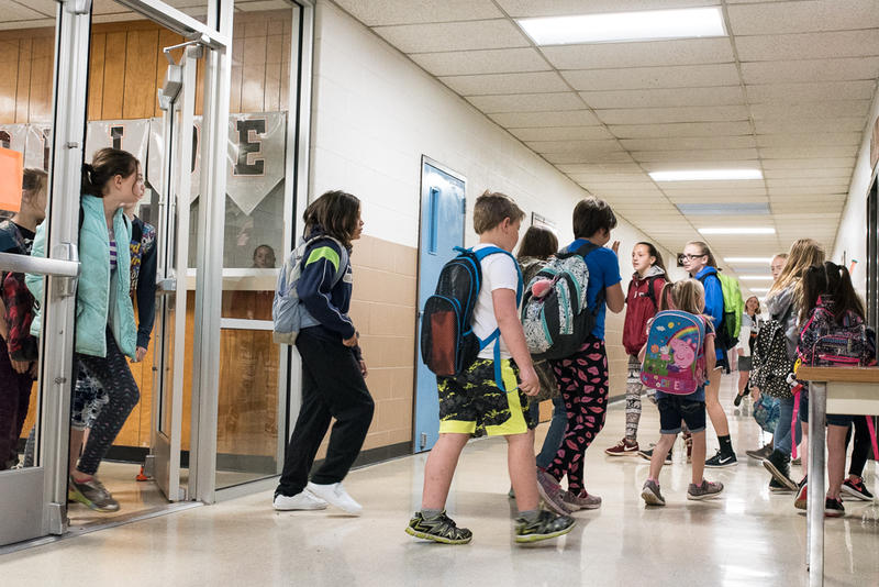 Students enter Lexington Elementary School on April 13 after the school was closed for nine school days during the teacher walkout.