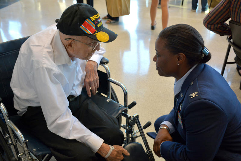 Col. Stephanie Wilson, 72nd Air Base Wing and installation commander, talks with Bob Hedgecoke, 93, of Guthrie, during a sendoff reception for Honor Flight veterans Sept. 15, 2015 at Rose State College.
