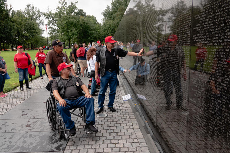 S. Joe Crittenden, Deputy Principal Chief of the Cherokee Nation, places a hand on the wall of the Vietnam Veterans Memorial.