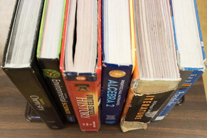 Textbooks are shown lined up on a desk at Putnam City High School in Oklahoma City in April.