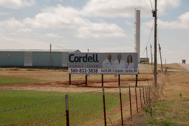 A billboard advertises the services of Cordell Memorial Hospital's only doctor and two nurse practitioners.