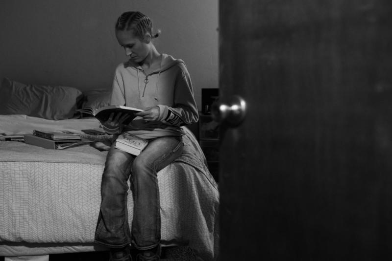 Taylyr Williams, 27, sits on her bed in Oxford House Elmhurst in Norman, where she has lived since January. Williams is one of only 40 Oxford House residents statewide taking medication prescribed to treat opioid addiction.