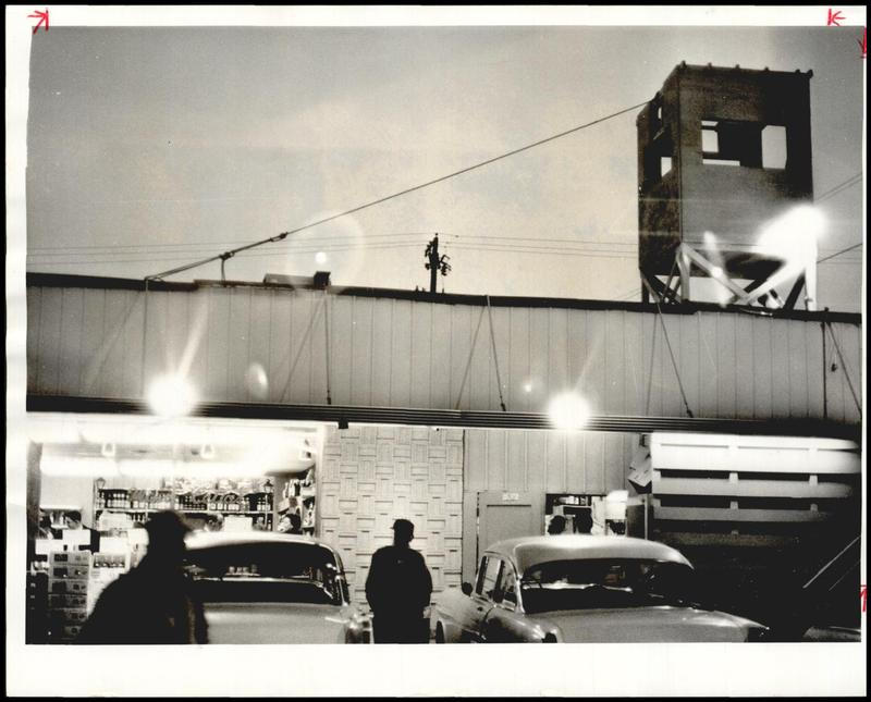 A photo from the Daily Oklahoman in December 1964 shows a tower atop Byron's liquor store.
