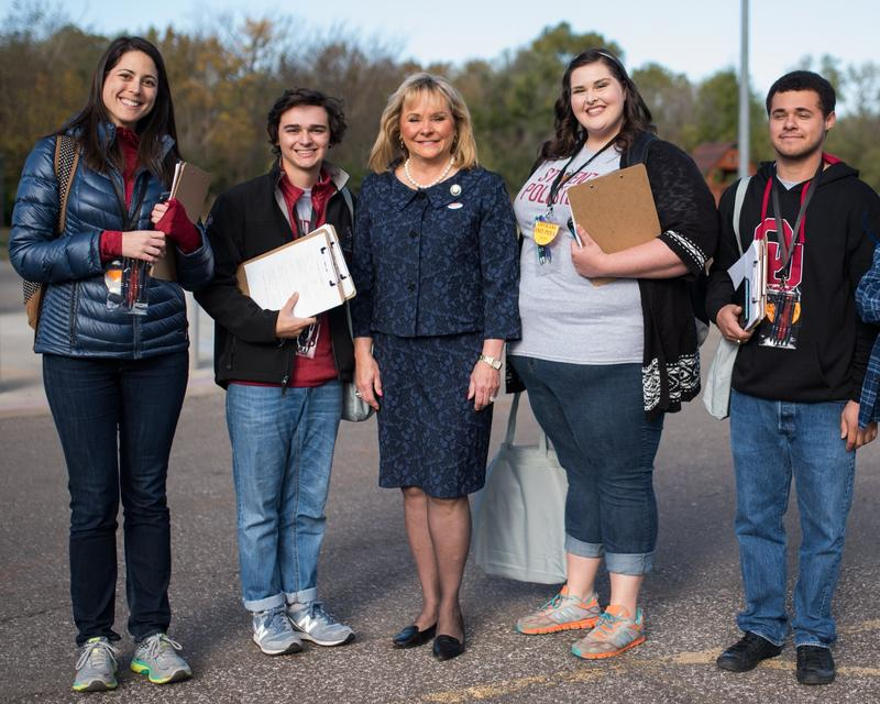 Dr. Allyson Shortle (left) stands with students and Gov. Mary Fallin on election day, Nov. 6, 2018, when they conducted exit polling in Oklahoma County.