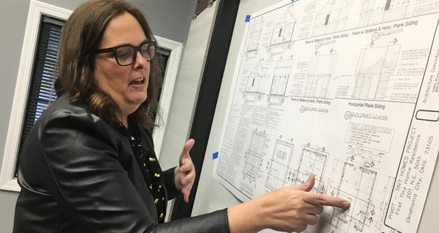 Melanie Anthony, vice president of development and community engagement at Pivot, points out the design of the nonprofit's tiny houses. Construction will start by year's end on the first six homes.