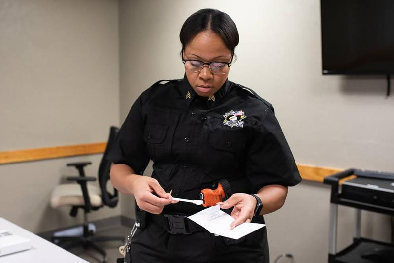 Sgt. Ziakiya Byers, an Oklahoma County Sheriff's deputy, shows a kit that is used to obtain DNA from convicted and arrested felons.