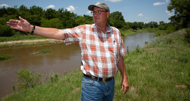 Landowner David Griesel stands in his property in El Reno.