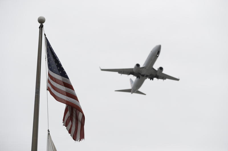 A commercial airplane makes its final approach into O'Hare International Airport