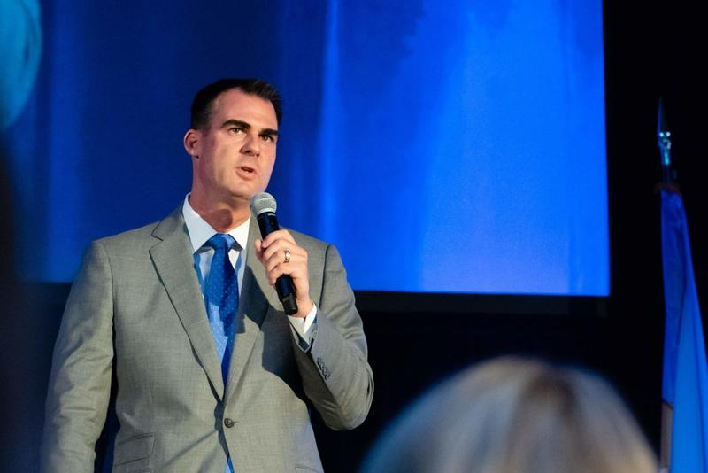 Kevin Stitt is shown speaking at a forum in Oklahoma City in August during the campaign.