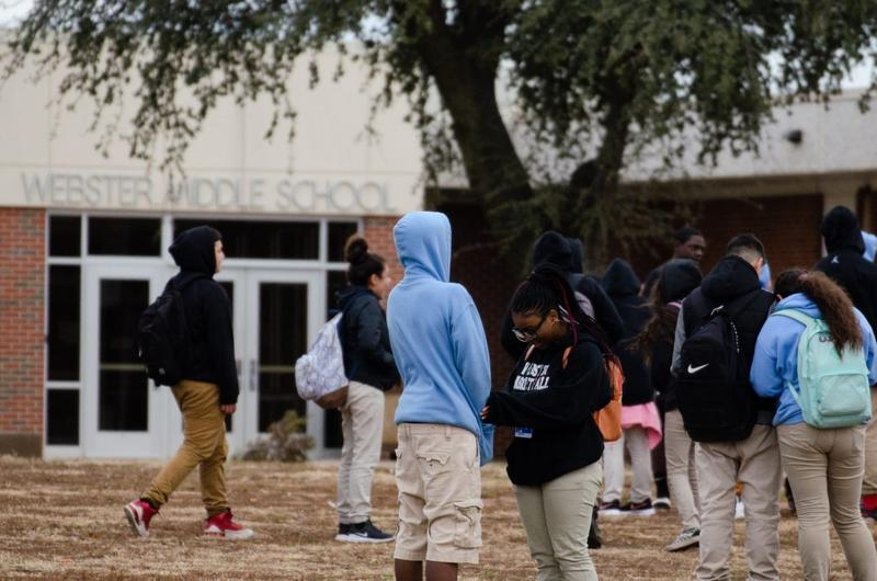 Students gather outside of Webster Middle School after classes on Jan. 24, 2019. Middle schools would include fifth-graders under an Oklahoma City Public Schools proposal.