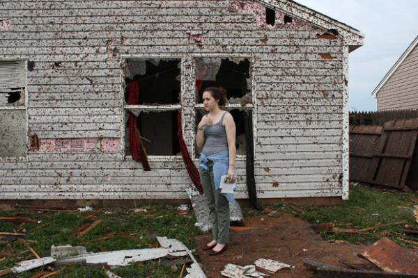 Lauren Gardner stands near a family members house, which was destroyed by the tornado.