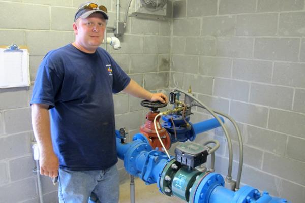 Norman, Okla., well operator Scott Lewis with Well No. 52, one of 36 that serve Norman.