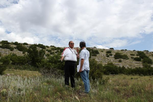 Logan Layden talks with Kiowa historian 'Joe Fish' DuPoint about the potential impact of limestone mining on Longhorn Mountain in August 2013.