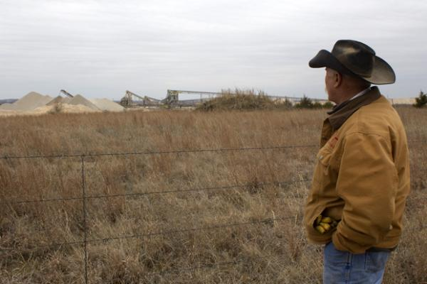 Johnston County Landowner Clyde Runyon just outside a limestone mining operation near Mill Creek, Okla.