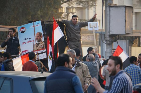A supporter of presidential candidate Abdel-Fattah el-Sissi chants in the street - January 25, 2014.