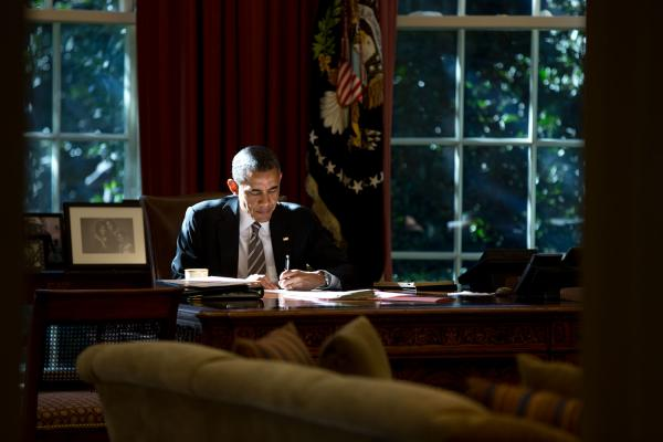 President Obama at the Resolute Desk in the Oval Office