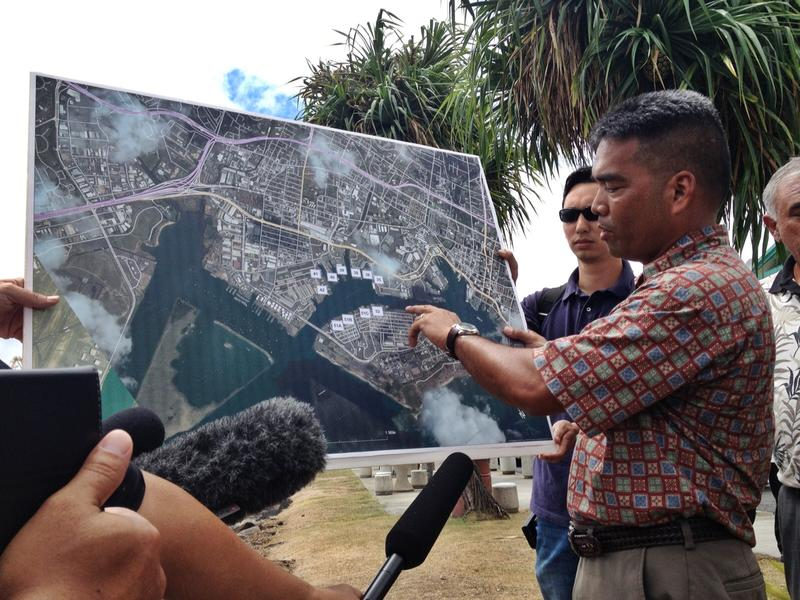 Matson senior executive Vic Angoco points out the pipe where the molasses spill occurred on a map of Pier 52.