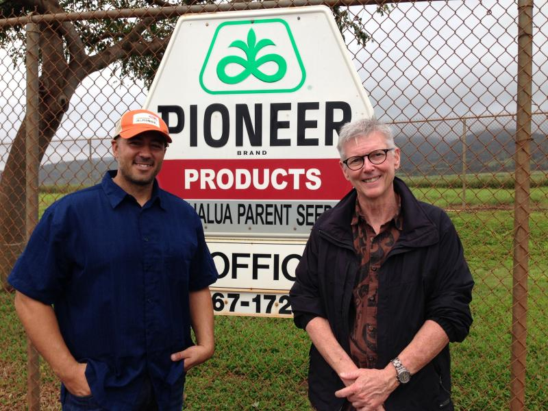 Dupont-Pioneer field operations manager, Alika Napier and operations lead, Richard McCormack in front of their company sign in Waialua.