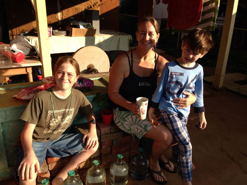 Jenny Piltz (center) and her sons, Hana (left) and Luke with their bottled water