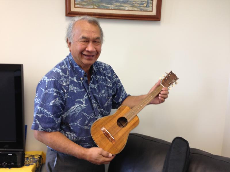 Senator Gilbert Kahele shows off his ukulele.