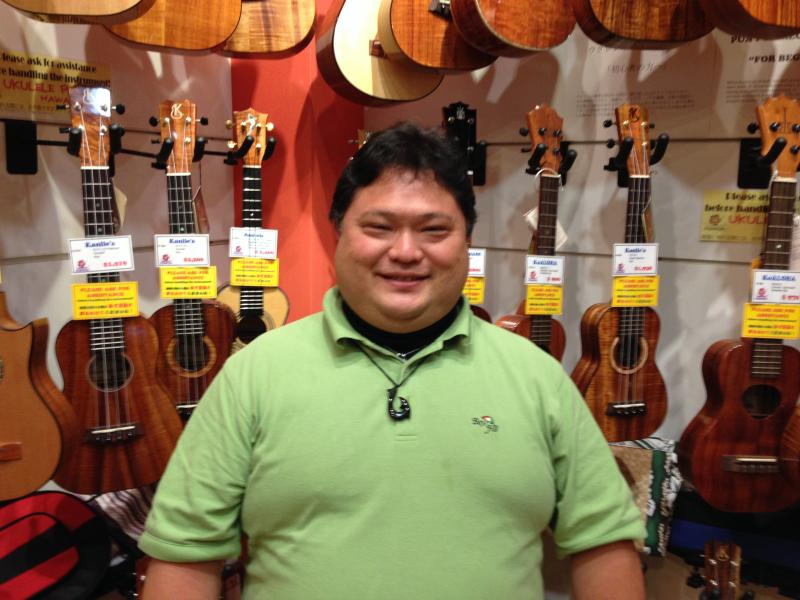 Daniel Akimoto works in a Waikiki ukulele store that sells 10-15 instruments each day.