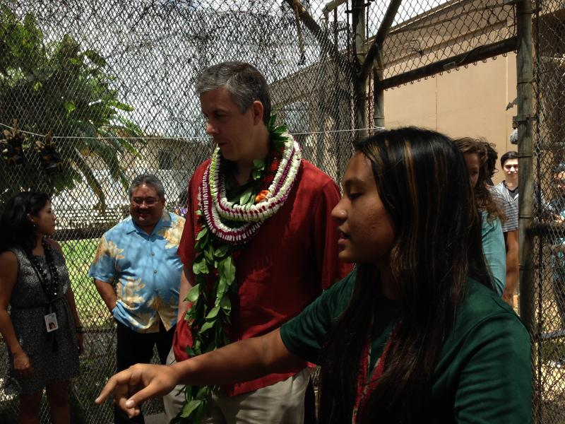 Briana Banua describes the aquaponics system at Waipahu High School to Education Secretary Arne Duncan.