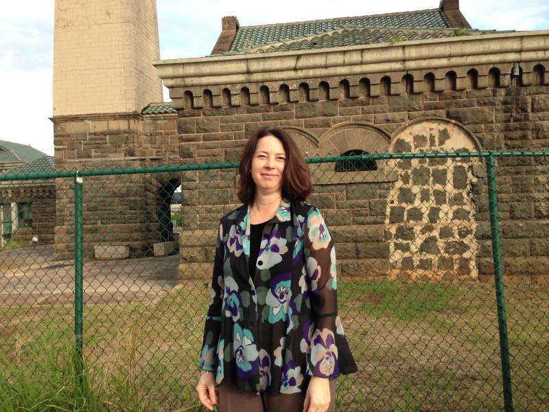 Kiersten Faulkner, executive director, Historic Hawai'i Foundation, stands on the side entrance of the 114 year-old structure.