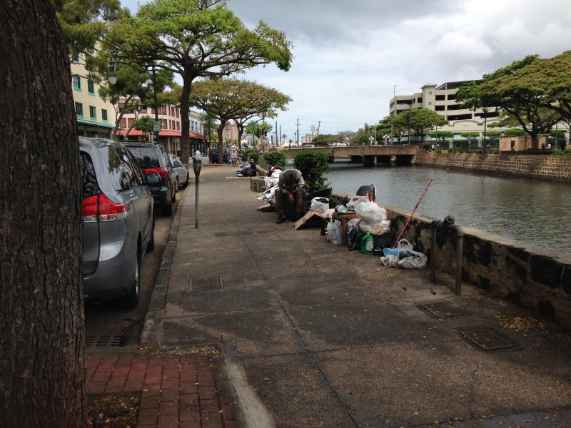 River Street sidewalk with homeless squatters adjacent to Nuuanu Stream
