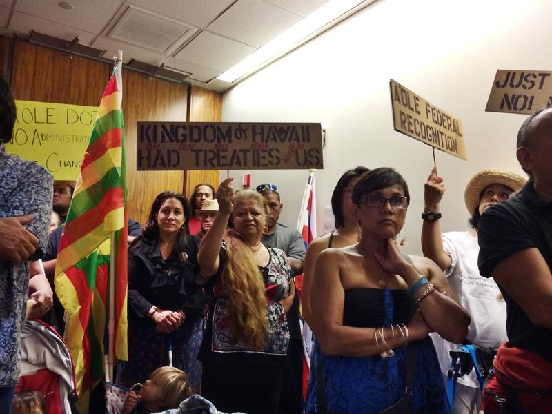 Protesters filled the State Capitol auditorium at the first of 15 public meetings.