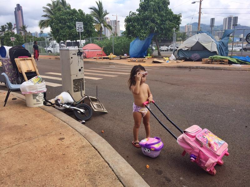 Most of the homeless living in the Kakaako neighborhood are families. 3-year-old Talia Martin helps her family pack up their belongings in the spot they've lived on Ohe St. for more than a year.